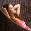 Young beautiful woman relaxing at the sunbed - Stock Photo