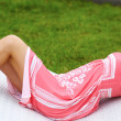 Young beautiful woman relaxing on the sunbed - Stock Photo