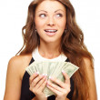Dreamy young woman holding a fan of U.S dollars - Stock Photo