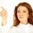 Young businesswoman press invisible button - Stockfoto