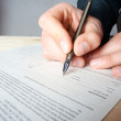 Close-up of filling in the questionnaire - Stock Photo