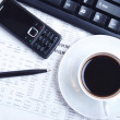 Cup of black coffee on morning newspaper - Stock Photo
