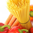 Fresh vegetables and pasta on white background - Stock Photo