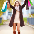 Royalty-Free Stock Photo: Full length happy young woman with shopping bags