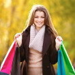 Excited young woman with her shopping bags - Stock Photo