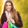Royalty-Free Stock Photo: Excited young woman with her shopping bags