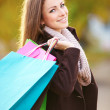Portrait of happy gir with shopping bags - Stock Photo