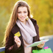 Woman with shopping bags digital tablet - Stock Photo