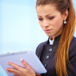 Businesswoman working on digital tablet - Stock Photo
