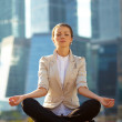 Royalty-Free Stock Photo: Business woman meditating outdoor