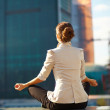Business woman meditating outdoor - Stok fotoğraf