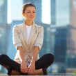 Business woman meditating outdoor - Stock Photo