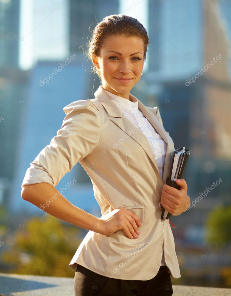 Portrait of cute young business woman outdoor over building background  Stock Photo #14088309