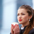 Business woman outdoor with coffee cup - Stock Photo