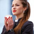 Business woman outdoor with coffee cup - Stock fotografie
