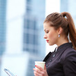 Woman with coffee cup and digital tablet - Stock fotografie