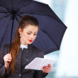 Business woman with digital tablet and umbrella - Stock fotografie