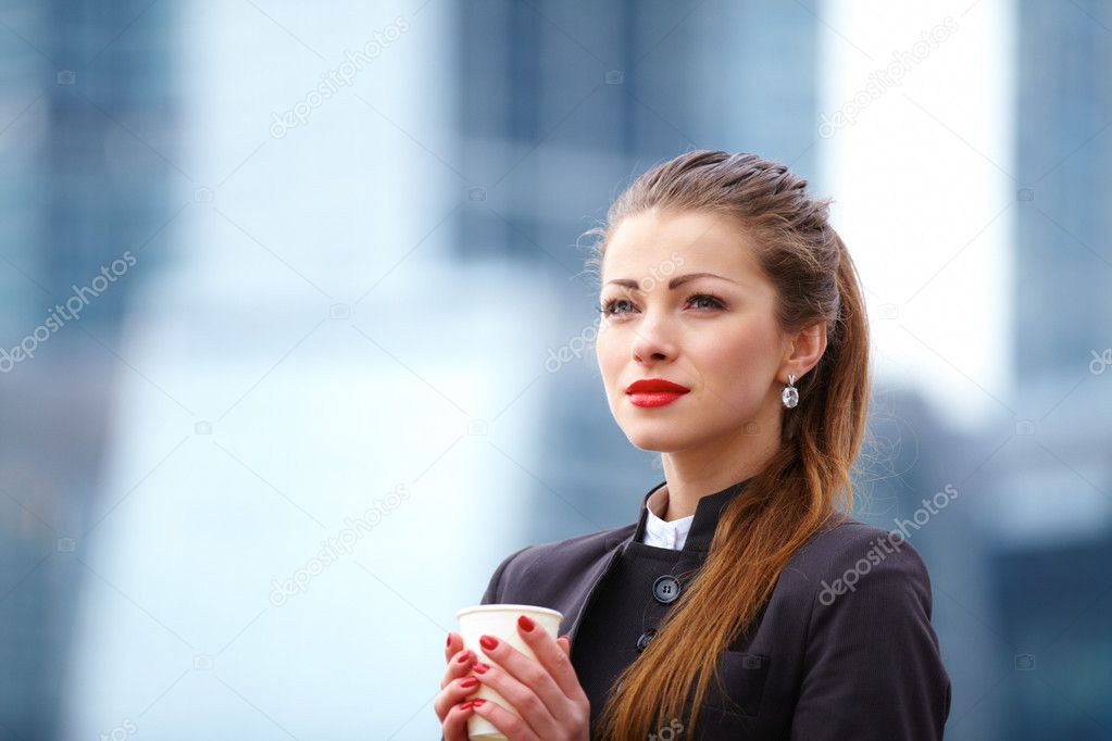 Portrait of cute young business woman outdoor with coffee cup  Stock Photo #14757097