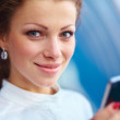 Pretty young business woman using mobile phone outdoor - Stockfoto