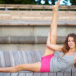Portrait of a pretty young fit woman doing yoga exercise - Stockfoto