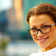 Portrait of cute young business woman outdoor - Stock Photo