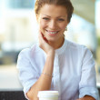 Young woman with coffee - Stock Photo
