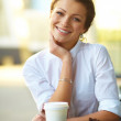 Young woman with coffee - Stock fotografie