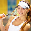 Royalty-Free Stock Photo: Portrait of a young female tennis player with racquet