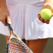 Royalty-Free Stock Photo: Young tennis player standing ready for a serve