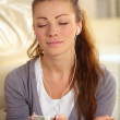 Pretty relaxed woman wearing headphones - Stok fotoğraf