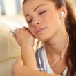Pretty relaxed woman wearing headphones - Stock Photo