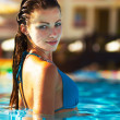 Young female relaxed and peaceful in her pool - Stockfoto