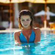 Young female relaxed and peaceful in her pool - Stok fotoğraf