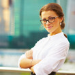 Portrait of cute young business woman outdoor - Стоковая фотография