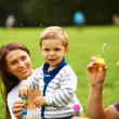 Portrait of happy family having fun outdoor - Stock Photo