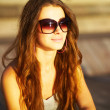 Happy young woman with sunglasses - Photo