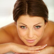 Beauty woman in spa lying down - Stock Photo