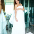 Gorgeous young woman draped in a white duvet - Foto de Stock