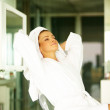 Beautiful woman wearing bathrobe and relaxing - Stock Photo