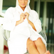 Beautiful woman wearing bathrobe and relaxing - Foto de Stock  