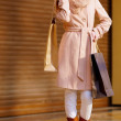 Woman shopping and holding bags at the mall - Stock Photo