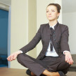Business woman doing yoga at the office - Zdjęcie stockowe