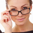 Shocked woman wearing glasses isolated - Stock Photo