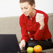 Professional young woman working from home - Stock Photo