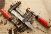 Bar clamps in workshop — Stock Photo
