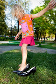 Youg girl in adult shoes — Stock Photo