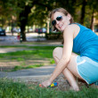 Young girl laughing in a park — Foto de Stock