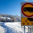Traffic sign warns of snow and ice, on sunny and snowy day — Stock Photo