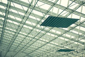 Modern glass roof and steel columns. — Stock Photo