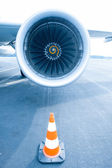 Jet engine with traffic cone in front — Stock Photo